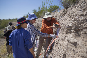 Faculty Tineke Van Zandt (center) explains to Chris La Roche (right) and another student how to profile rock layers at the simulated archaeology site at West Campus.