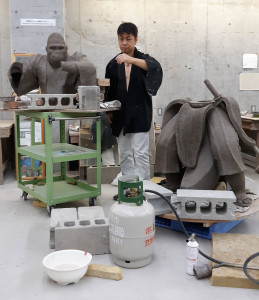 "Hiro Tashima working on ""Little Boy"" at the artist-in-residence program in Shigaraki Ceramic Cultural Park in Japan."